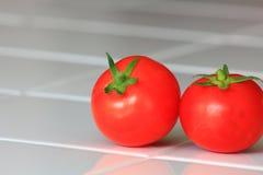 Pair of organic tomatoes Stock Photo