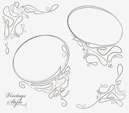 Pair of oval outline frame and decorative corner elements. Stock Photos
