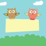 Pair of owls fly with banner Royalty Free Stock Photo