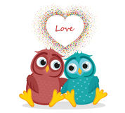 Pair owls in love. Vector. Colorful confetti in the form of heart. A pair of cute owls in love. Vector. Colorful confetti in the form of heart. Greeting card or Royalty Free Stock Image