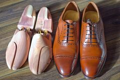 Men`s shoes and shoe tree. A pair of oxford shoes and shoetree Royalty Free Stock Photography