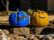Pair of painted pumpkins smile at passerbys Royalty Free Stock Image