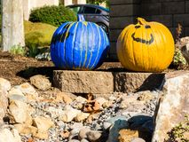 Pair of painted pumpkins greet passerbys Stock Photos