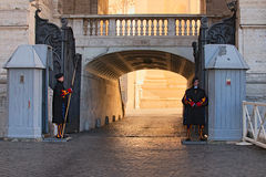 Pair of Papal Swiss guards stand guard at the entrance of Saint Peter`s Basilica. Swiss Guards in their traditional uniform. VATICAN CITY, VATICAN – 07 stock photography