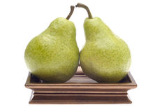Pair of Pears on a Golden Dish Royalty Free Stock Photos