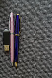 Pair of Pens and Flash Drive. A series of photos with stationery items Royalty Free Stock Photos