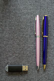 Pair of Pens and Flash Drive. A series of photos with stationery items Stock Photos