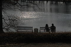 Pair of people and benches Stock Photos