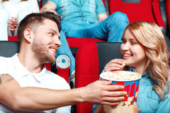 Pair of people sharing popcorn Stock Photo