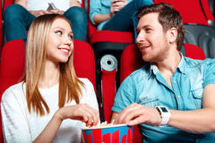 Pair of people sharing popcorn Royalty Free Stock Image