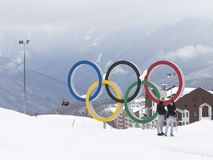 The pair is photographed near the Olympic rings, Sochi. Sochi - March 29, 2017: A man and a woman make a selfie near the Olympic rings in the Olympic ski cluster Royalty Free Stock Photos