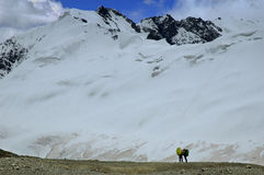 A pair of photographers in mountains. A pair of mountaineers photographing majestic landscape Stock Photography