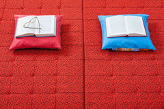 Pair of pillows and books Royalty Free Stock Photos
