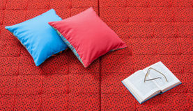 Pair of pillows and books Stock Images