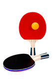 Pair of ping-pong rackets and orange ball on white Royalty Free Stock Photos