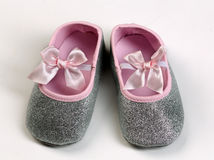 Pair of pink baby booties. Royalty Free Stock Photos