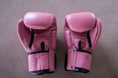 Pair of pink boxing gloves Royalty Free Stock Image