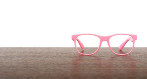 Pair of pink eyeglasses on table Stock Photography