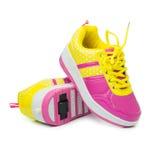 Pair of pink heelys Stock Photos