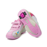 Pair of pink heelys Royalty Free Stock Photography