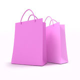 Pair of pink shopping bags. 3D rendering of two pink shopping bags against a white background Royalty Free Stock Photography