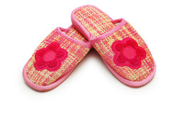 Pair of pink slippers. Isolated on white stock images