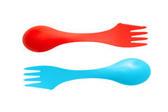 Pair of plastic varicolored camping cutlery tools spoons and for Stock Photography