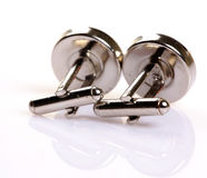 Pair of platinum cufflinks. Isolated on white background stock images