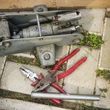 A pair of pliers and old Jack Royalty Free Stock Photo