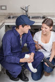 Pair of plumbers with tools Royalty Free Stock Image