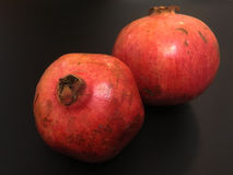 Pair of Pomegranate. This photo is shot in black background and highlight the red pomegranate Stock Photography