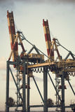 A pair of port cranes Royalty Free Stock Image