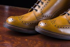 Pair of premium tanned brogue derby boots. Footwear and shoes concepts. Pair of Premium Tanned Brogue Derby Boots Made of Calf Leather with Rubber Sole. Shoot Stock Photography