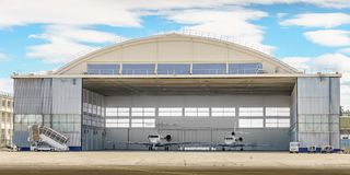 Private Jets in a Hangar. A pair of private jets sit in a hangar royalty free stock photo