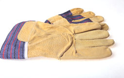 Pair of protective work gloves isolated on a white background. Royalty Free Stock Photography