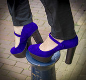 Pair of purple shoes women's heels on the column. A pair of purple shoes women's heels on the column Stock Images