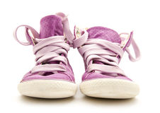 Purple sneakers. Pair of purple sneakers isolated on white background royalty free stock photography
