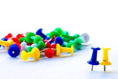 Pair of push pins. Standing apart from others. Close-up stock images
