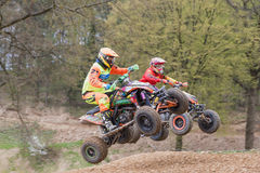 Pair of quad riders are jumping in the race Royalty Free Stock Images