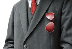 Pair of Red Aviators in Businessman's Pocket. With possible white copy space on the left side Royalty Free Stock Photos