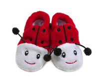 Pair of red baby booties in the form of a ladybug. Stock Photos