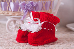 Pair of red booties stock photo