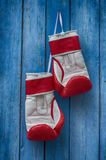 Pair of red boxing gloves hanging on a nail Stock Image