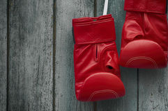 Pair of red boxing gloves on an old shabby  wooden wall Stock Image