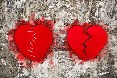 Pair of red broken hearts Stock Photo