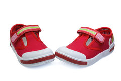 Pair of red child  sneakers Stock Photos