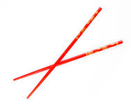 Pair of red chopsticks isolated Royalty Free Stock Image