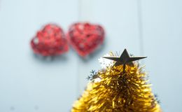 Pair of red decorative hearts on wooden background, Royalty Free Stock Photography