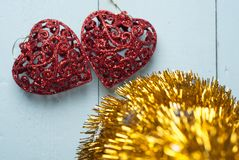 Pair of red decorative hearts on wooden background, Royalty Free Stock Image