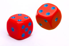 Pair of red dice. Pair of colorful red dice with blue dots, isolated on white background stock images